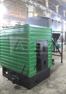 Механизированный котёл на опилках и щепе 300 КВт КВм-0,3Д с бункером топлива